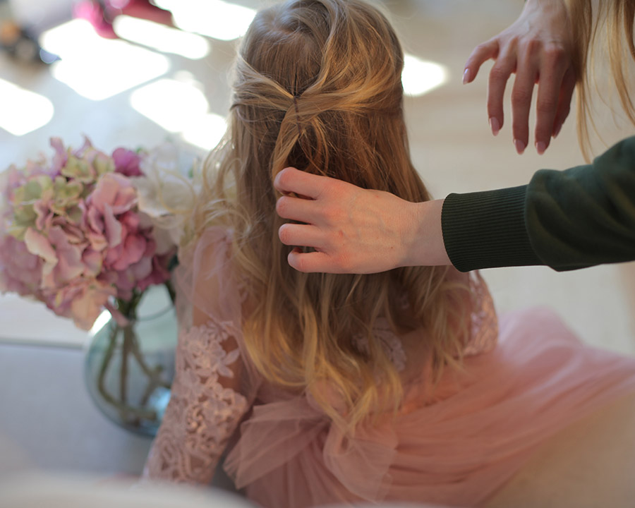 little girls hairstyling for bridesmaids at wedding