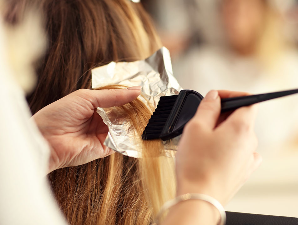 hair colour being applied to hair foils