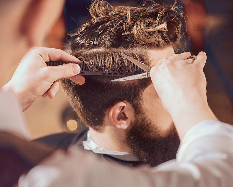 man with highlights in hair having a fade cut