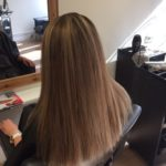 long haircut with blonde highlights