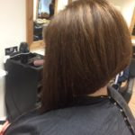 lady with angle bob hairstyle
