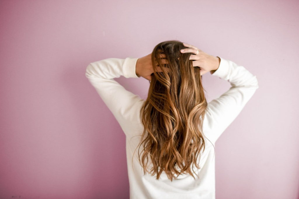 long blonde wavey hair with pink background